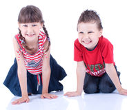Cute blue-eyed boy and girl posing in the studio Stock Images