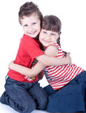 Cute blue-eyed children posing Royalty Free Stock Photos