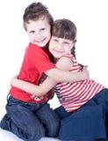 Cute blue-eyed children posing Royalty Free Stock Photos