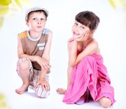 Cute blue-eyed children posing Royalty Free Stock Photography