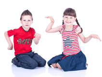 Cute blue-eyed children posing Royalty Free Stock Image