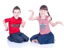 Cute blue-eyed children posing Royalty Free Stock Image