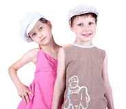 Cute blue-eyed children with whit caps Royalty Free Stock Photos