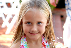 Cute Blue Eyed Girl. A beautiful little girl dressed in a tropical print dress  and big blue eyes Royalty Free Stock Photos