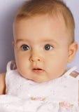 Cute blue-eyed toddler Stock Photos