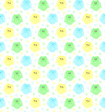 Cute blue, green and yellow owls with stars in the background Stock Images
