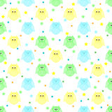 Cute blue, green and yellow owls with stars and dots in the back Royalty Free Stock Photography