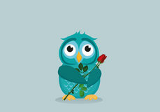 Cute blue owlet waiting to give a  of flower red rose as a gift Royalty Free Stock Photo
