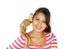 Cute Bolivian girl with wooden mannequin Stock Photo