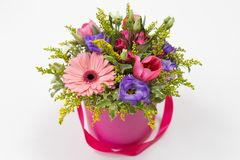 Free Cute Bouquet Pink, Yellow, Green, Purple Of Roses, Eustoma, Gerberas And Greenery In A Round Pink Cardboard Box Royalty Free Stock Images - 158874899