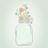 Cute bouquet of wedding flowers in a glass jar Stock Photography