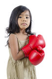 Cute boxer child wearing red boxing gloves Stock Photo
