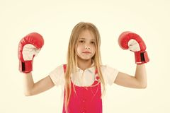 Cute boxer. Girl on dreamy calm face posing with boxing gloves, isolated white background. Kid long hair dreaming to be. Strong and independent. Independence stock photo