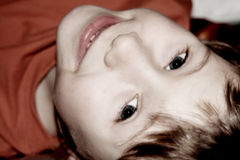 Cute boy. Portrait of a cute little caucasian boy looking overhead and smiling stock images