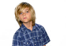 Cute boy. Cute young boy in blue shirt isolated on white background Stock Images