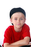 Cute Boy. Cute blue eyed preteen boy with red shirt and black cap isolated on white Royalty Free Stock Images