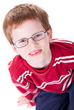 Cute Boy. Portrait of a cute young boy with glasses isolated on white background. Studio shot Stock Image