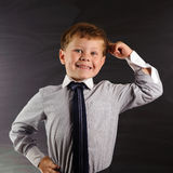 Cute boy against blackboard Royalty Free Stock Photos