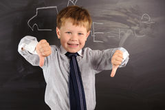 Cute boy against blackboard Royalty Free Stock Photography