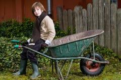 Cute Boy And Wheelbarrow Royalty Free Stock Photo