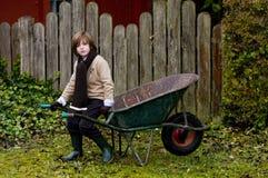 Cute Boy And Wheelbarrow Royalty Free Stock Image