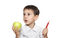 Cute boy with apple and pencil Stock Photo