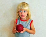 Cute boy with an apple Stock Photos