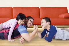 Cute boy arm wrestling with his dad Stock Images