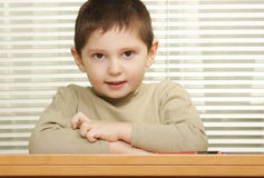 Cute boy arms folded Stock Photography