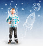 Cute boy as a small astronaut. With drawings stock photo