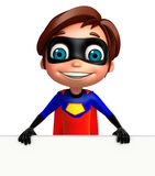 Cute boy as a superhero with white board Royalty Free Stock Image