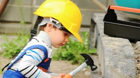 Cute boy as a worker match the tractor Royalty Free Stock Image