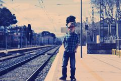 Free Cute Boy At The Train Station Waiting For The Train Royalty Free Stock Images - 115373769