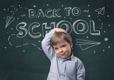 Cute boy with back to school concept. Adorable little boy with blackboard and back to school concept Stock Photo