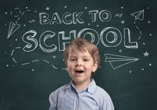 Cute boy with back to school concept. Adorable little boy with blackboard and back to school concept Royalty Free Stock Image