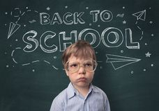 Cute boy with back to school concept. Adorable little boy with blackboard and back to school concept Stock Photography