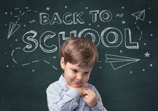 Cute boy with back to school concept. Adorable little boy with blackboard and back to school concept Royalty Free Stock Photography
