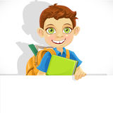 Cute boy with a backpack  hold big banner Stock Image
