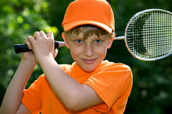 Cute boy with badminton racket Stock Photography