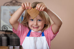 Cute Boy Baking Ginger Bread Cookies Royalty Free Stock Images