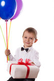 Cute boy with balloons and giftbox Stock Photography