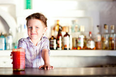 Cute boy at bar Stock Photos