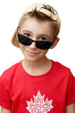 Cute boy in baseball cap. And sunglasses on white background Stock Photo