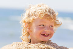 Cute boy at the beach Stock Images