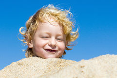 Cute boy at the beach Royalty Free Stock Image
