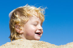 Cute boy at the beach Stock Image