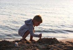 Cute boy on the  beach Stock Photos