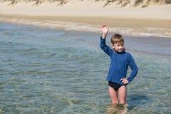 Cute boy on beach of sea royalty free stock photos