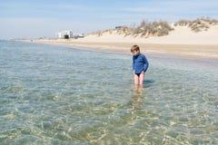Cute boy on beach of sea royalty free stock photo