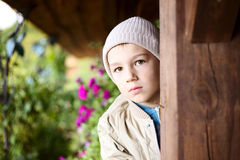 Cute boy behind a pillar Stock Images